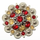 berry concho with red, amber and gray stones